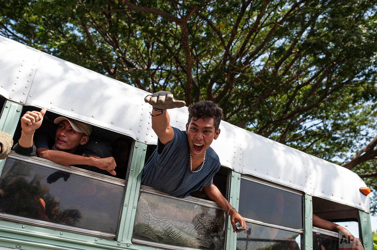 Students who had taken refuge in the Jesus of Divine Mercy church amid a barrage of armed attacks, arrive on a bus to the Cathedral in Managua, Nicaragua, July 14, 2018. Cardinal Leopoldo Brenes negotiated for the safe transfer of students who had sought refuge there when police forced them out of the National Autonomous University of Nicaragua, which had been occupied during two months of protests against the government of President Daniel Ortega. (AP Photo/Cristobal Venegas)
