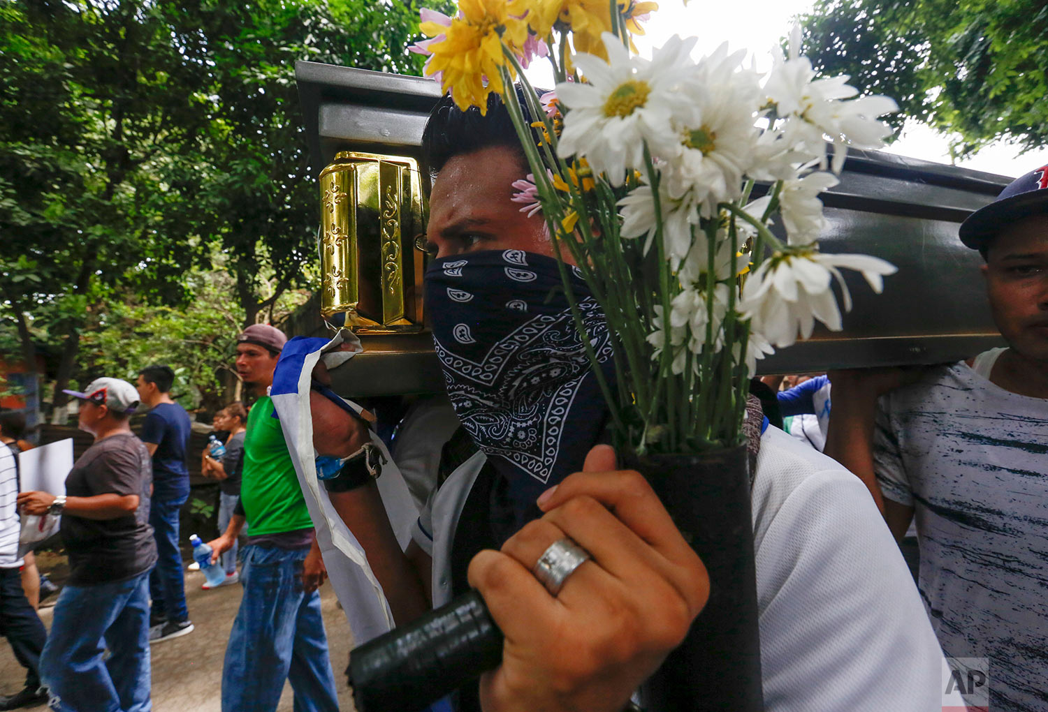 Friends and family carry the coffin of Gerald Vasquez, an engineering student who was killed during the July 14 attack by police and paramilitary forces to the National University of Managua, to be buried in Managua, Nicaragua, July 16, 2018. (AP Photo/Alfredo Zuniga)