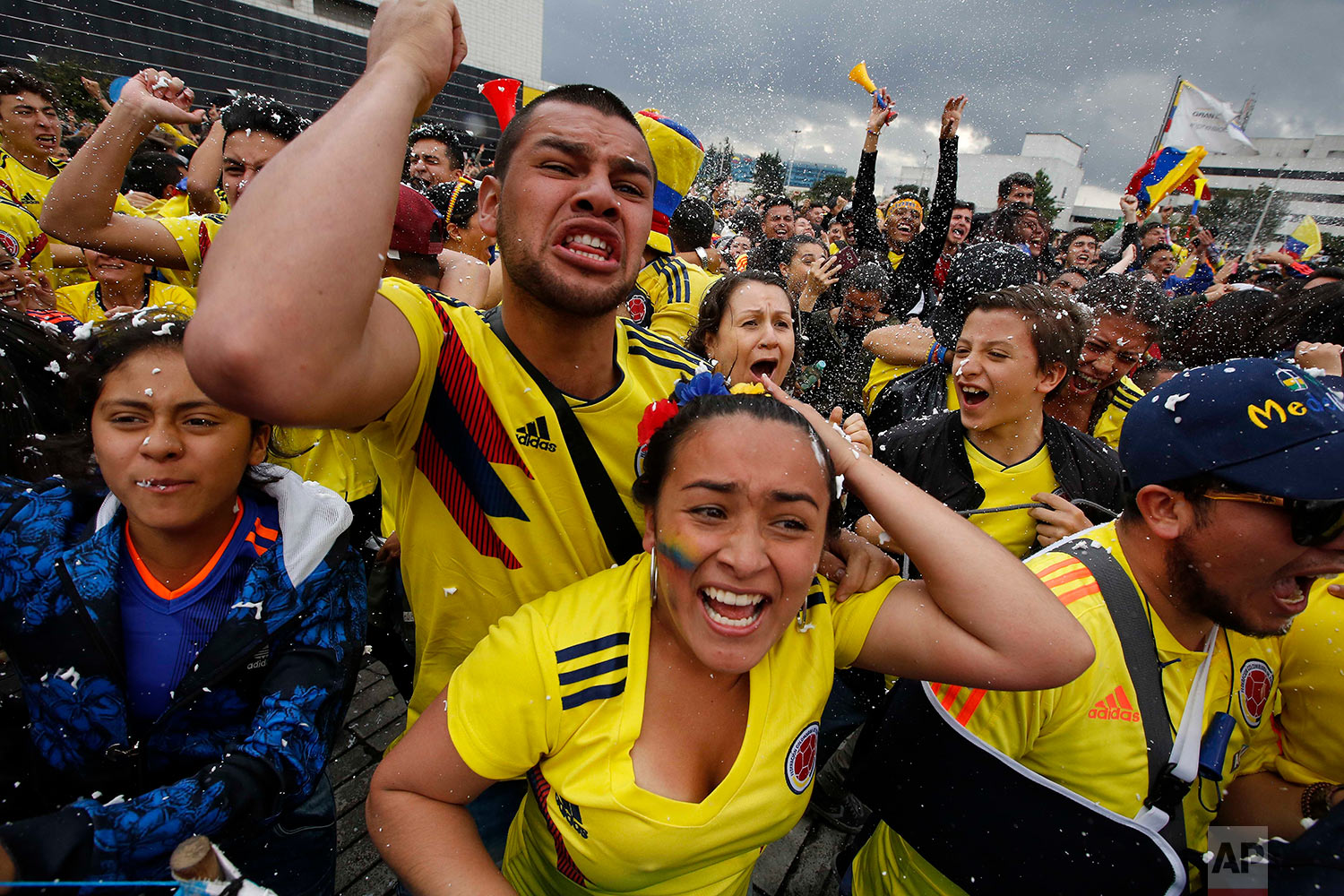 Colombian soccer fans watch a live telecast of a World Cup match between Colombia and England in Bogota, Colombia, July 3, 2018. Colombia lost the match in a penalty shootout. (AP Photo/Fernando Vergara)