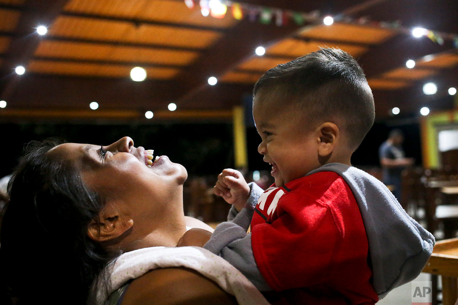 Adalicia Montecinos holds her 1-year-old son Johan, who became a poster child for the U.S. policy of separating immigrants and their children, in Yojoa, Honduras, July 20, 2018. Johan arrived in San Pedro Sula and was reunited with his parents. Captured by Border Patrol agents in March, Johan's father was deported and the then 10-month-old remained at an Arizona shelter. (AP Photo/Esteban Felix)