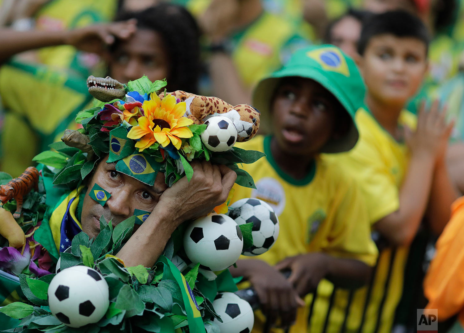 Brazil soccer fans react at the end of a live broadcast of a World Cup quarterfinal match with Belgium in Rio de Janeiro, Brazil, July 6, 2018. Belgium knocked Brazil out of the World Cup and advanced to the semi-finals. (AP Photo/Leo Correa)