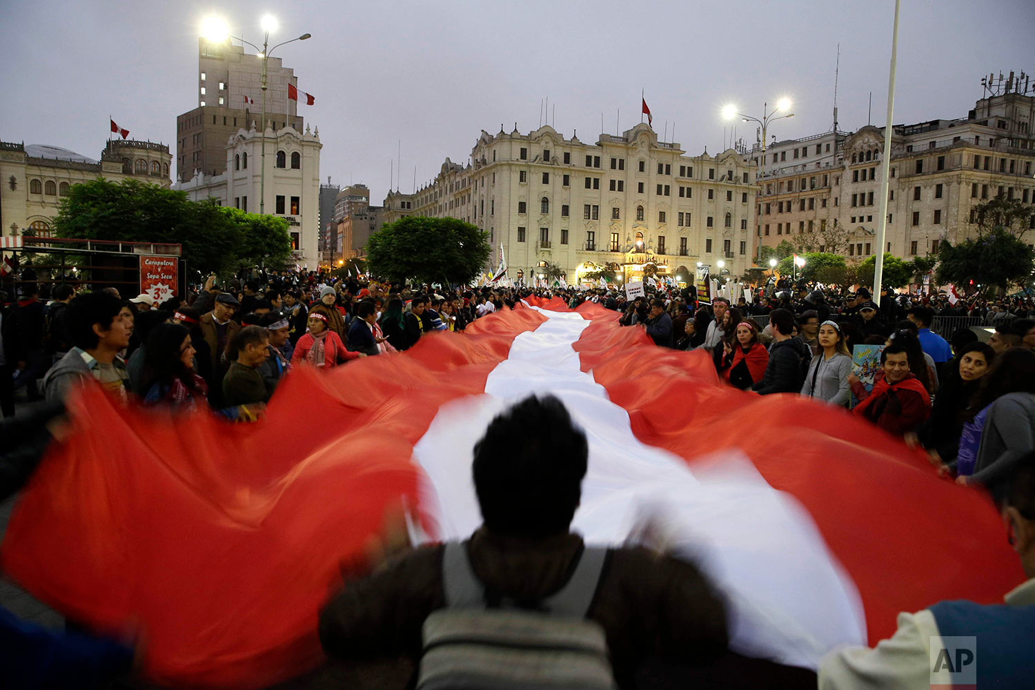 Demonstrators protest corruption at San Martin plaza in Lima, Peru, July 19, 2018. The latest scandal to embroil this South American nation has ensnared some of the country's highest-ranking judges and political officials and comes just four months after then-President Pedro Pablo Kuczynski stepped down in a separate corruption probe. (AP Photo/Martin Mejia)