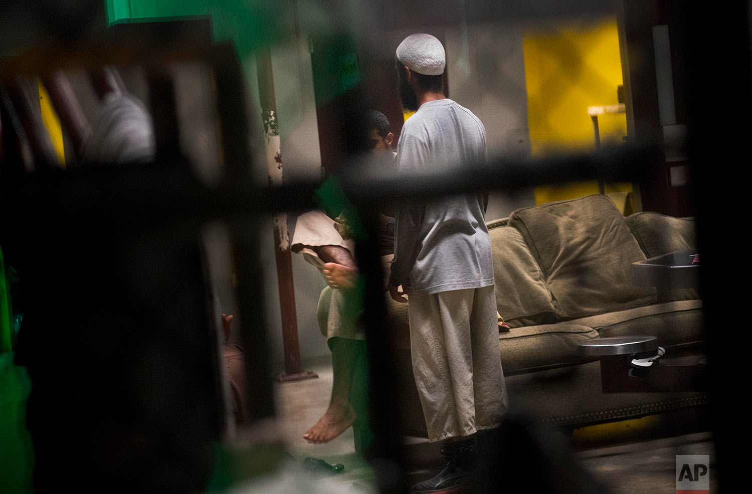 Detainees chat before evening prayers inside the Camp VI detention facility at the naval base at Guantanamo Bay, June 6, 2018. This is a recreational space where detainees can visit and eat meals.