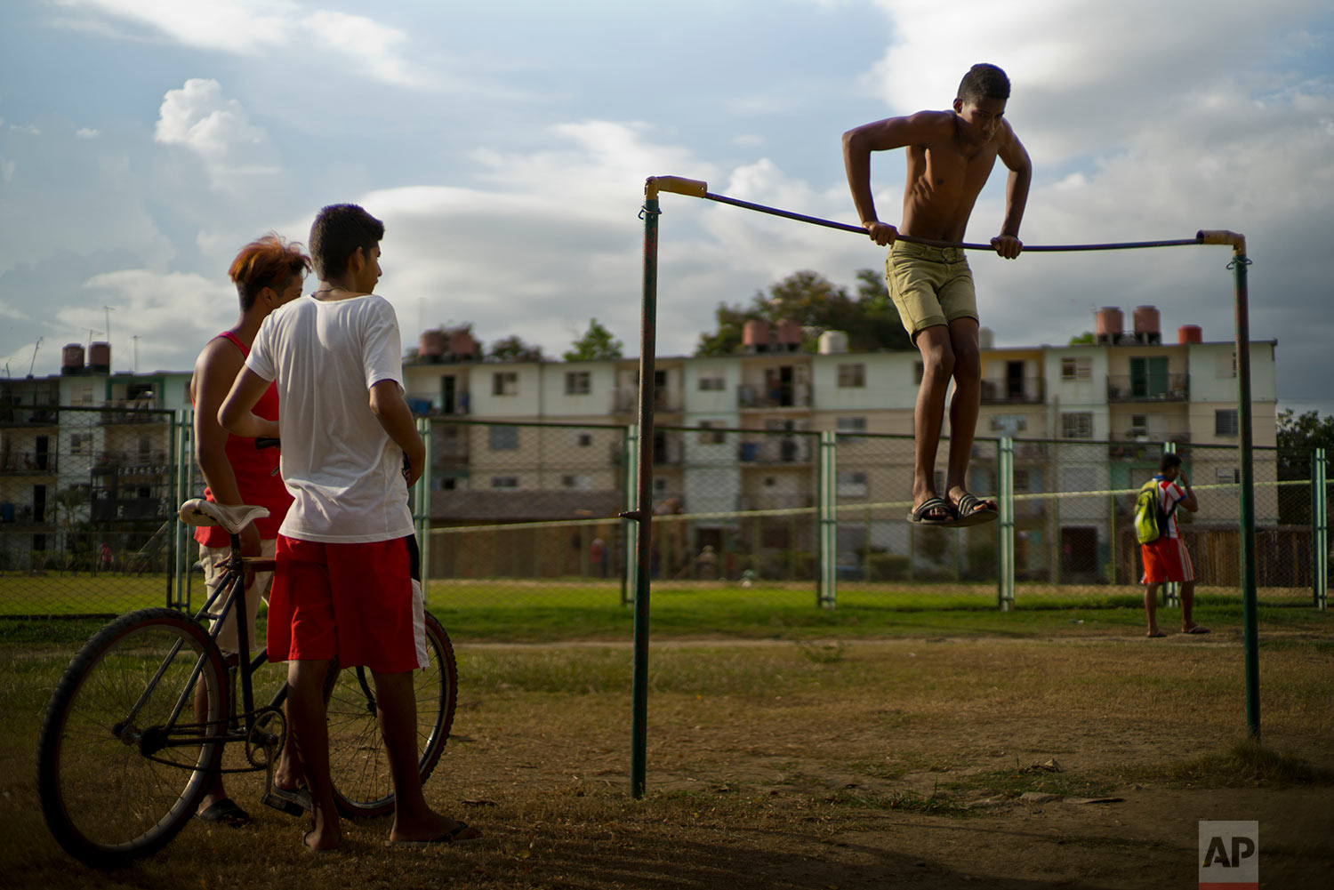 A youth works out on an exercise bar at a park by Plaza de la Revolucion in Guantanamo, Cuba,July 24, 2018.