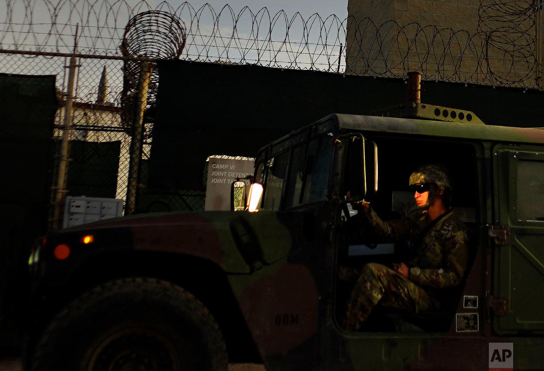 A U.S. solider drives a military vehicle past Camp VI at the naval base at Guantanamo Bay,June 5, 2018.