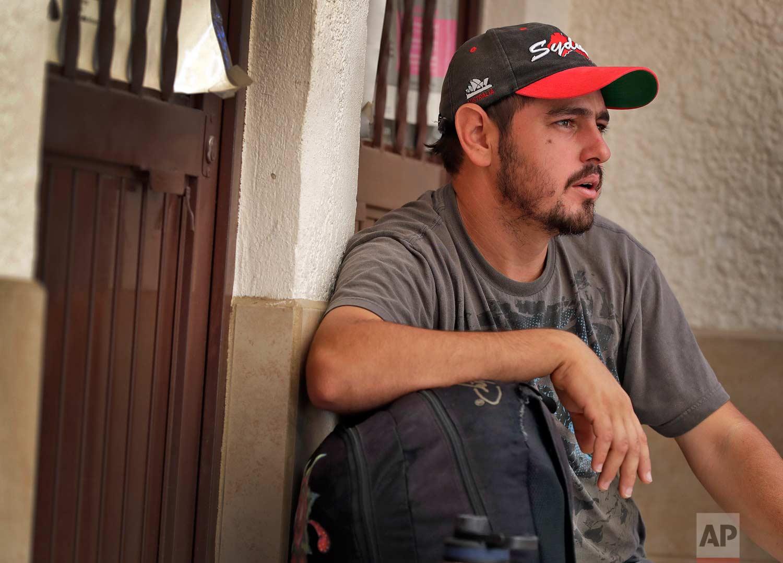 "Jose Blanco, of Honduras, sits with his belongings at the Asociacion Casa Del Migrante ""La Divina Providencia"" group house Thursday, July 19, 2018 in San Luis, Sonora, Mexico. (AP Photo/Matt York)"