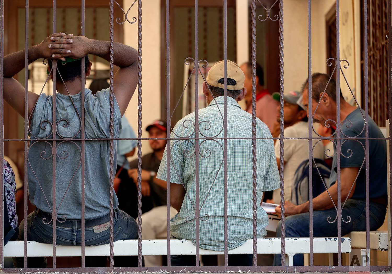 "Central American men sit inside the Asociacion Casa Del Migrante ""La Divina Providencia"" group house Thursday, July 19, 2018 in San Luis, Sonora, Mexico. (AP Photo/Matt York)"