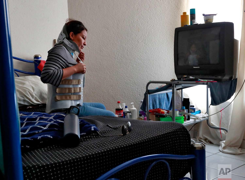 "Socorro Reyes sits alone in her room at the Asociacion Casa Del Migrante ""La Divina Providencia"" group house Thursday, July 19, 2018 in San Luis, Sonora, Mexico. (AP Photo/Matt York)"