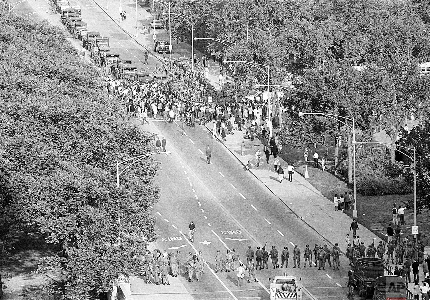 Illinois National Guardsmen are stationed at the end of a bridge in Chicago's Grant Park on August 28, 1968, as police try to cope with an estimated 9,000 anti-war demonstrators. They were under orders to help police prevent the demonstrators from marching on the International Amphitheater where Democrats were holding their presidential nominating session tonight. (AP Photo)