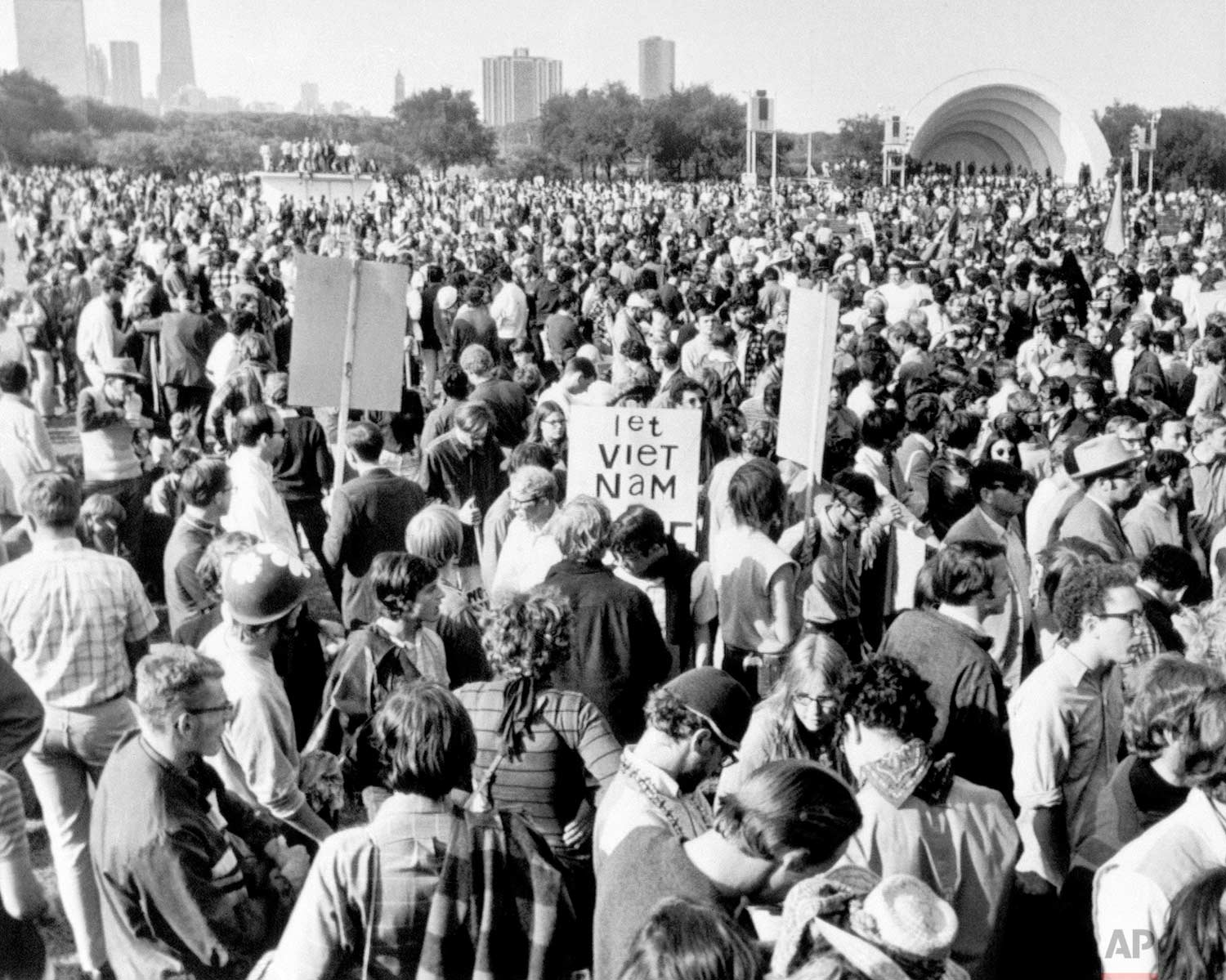 An estimated 9000 anti-war demonstrators gather in Chicago's Grant Park on August 28, 1968, with the announced intention of marching on the site of the Democratic National Convention, the International Amphitheater. Police, who had warned the march would not be permitted, moved into the middle of the crowd swinging clubs and were showered with rocks, bottles and trash in return. (AP Photo)