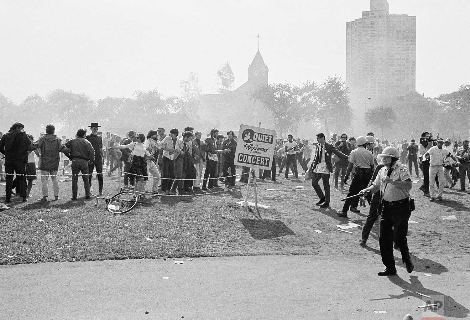 Club-wielding Chicago police move against anti-war demonstrators massed in the city's Grant Park August 28, 1968. The clash began when officers rescued several policemen who were surrounded by the crowd while arresting a protestor. The police used clubs and tear gas and were showered with rocks, bottles and trash in return. (AP Photo).
