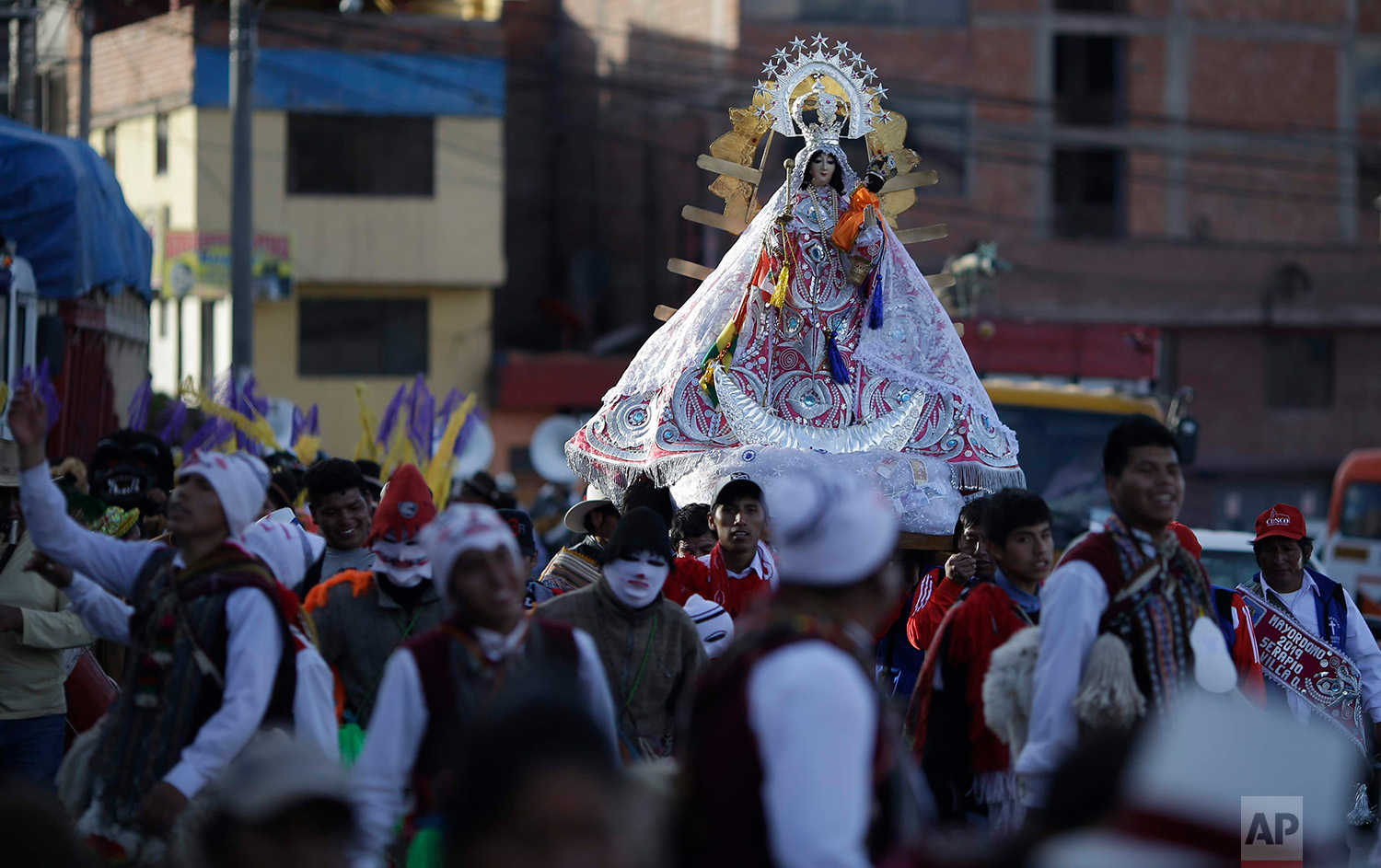Devotees take part in a religious procession honoring Our Lady of Copacabana, in Cuzco, Peru, Aug. 5, 2018. The veneration of Bolivia's patron saint in Cuzco began a decade ago with a small feast among friends and family.  (AP Photo/Martin Mejia)