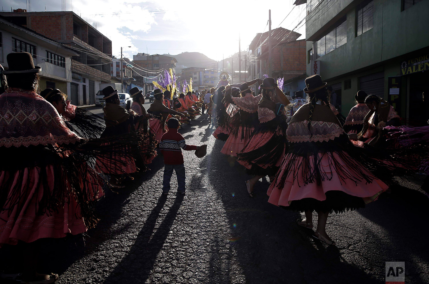 """Dance troupes perform the """"Morenada"""" or Dance of the Black Slaves, during celebrations honoring Our Lady of Copacabana, in Cuzco, Peru, Aug. 5, 2018. The traditional Bolivian dance is comprised of a synergistic mix of African and Aymara influences. (AP Photo/Martin Mejia)"""
