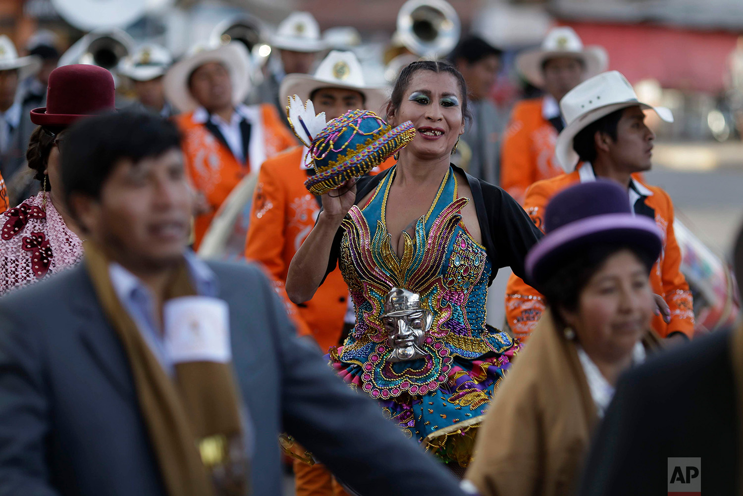 """Transgender Paloma, dressed as a dancer known as a """"china"""" for the """"Morenada"""" or Dance of the Black Slaves, takes part in a religious procession in honor of Our Lady of Copacabana, in Cuzco, Peru, Aug. 5, 2018. A group of transsexual activists in Cuzco have adopted the Bolivian virgin as their patron saint. (AP Photo/Martin Mejia)"""