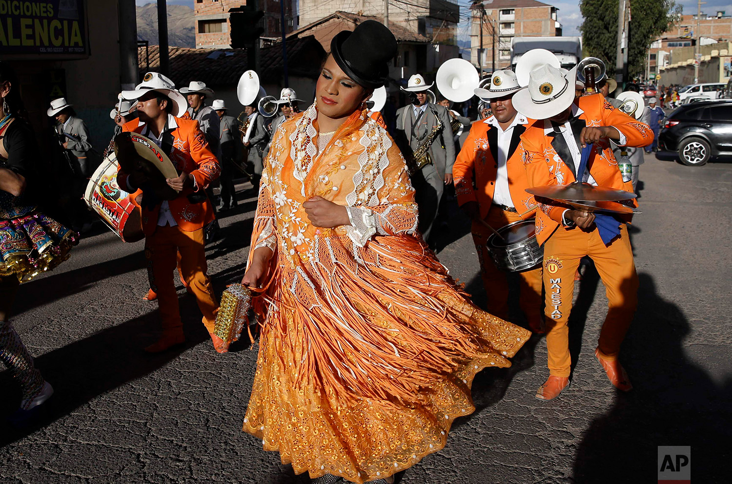 """Transgender Jessi dressed as a """"chola"""" takes part in the celebrations honoring Our Lady of Copacabana, in Cuzco, Peru, Aug. 5, 2018. Jessi and her friends dance in hope their celebratory tribute will help ward off violence and harassment in a country where being transgender can prove deadly. (AP Photo/Martin Mejia)"""