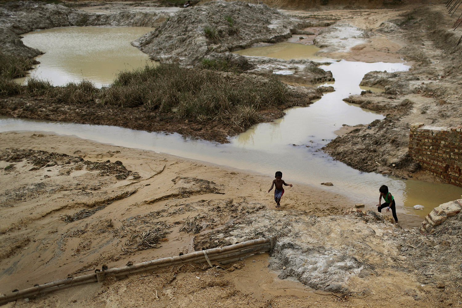 Rohingya children play next to a river in the Kutupalong refugee camp in Bangladesh on Thursday, June 28, 2018. (AP Photo/Wong Maye-E)
