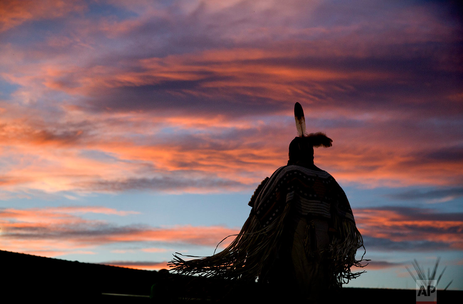 A woman performs a traditional Native American dance during the North American Indian Days celebration on the Blackfeet Indian Reservation in Browning, Mont., Friday, July 13, 2018.(AP Photo/David Goldman)