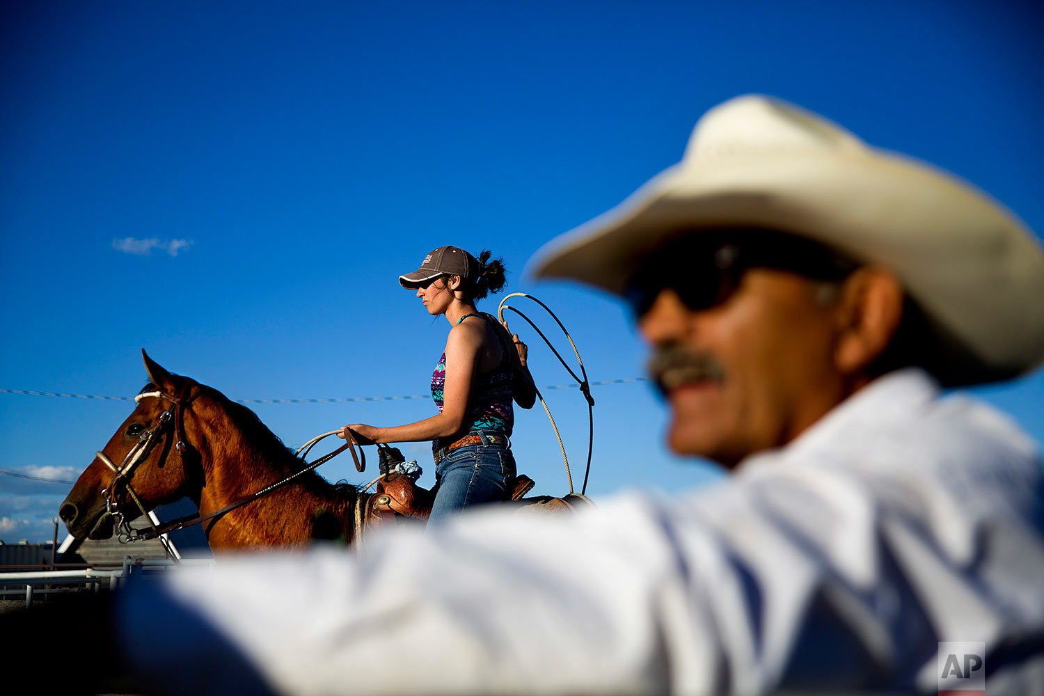 A female contestant waits to rope a calf during a practice run for a rodeo competition on the Blackfeet Indian Reservation in Browning, Mont., July 10, 2018. (AP Photo/David Goldman)