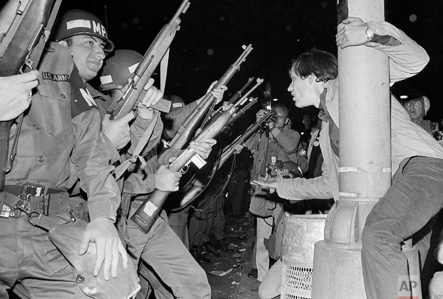 Jeers greet Chicago police officers as they attempt to disperse demonstrators outside the Conrad Hilton, Democratic Convention headquarters hotel Wednesday, August 29, 1968. (AP Photo/RHS)