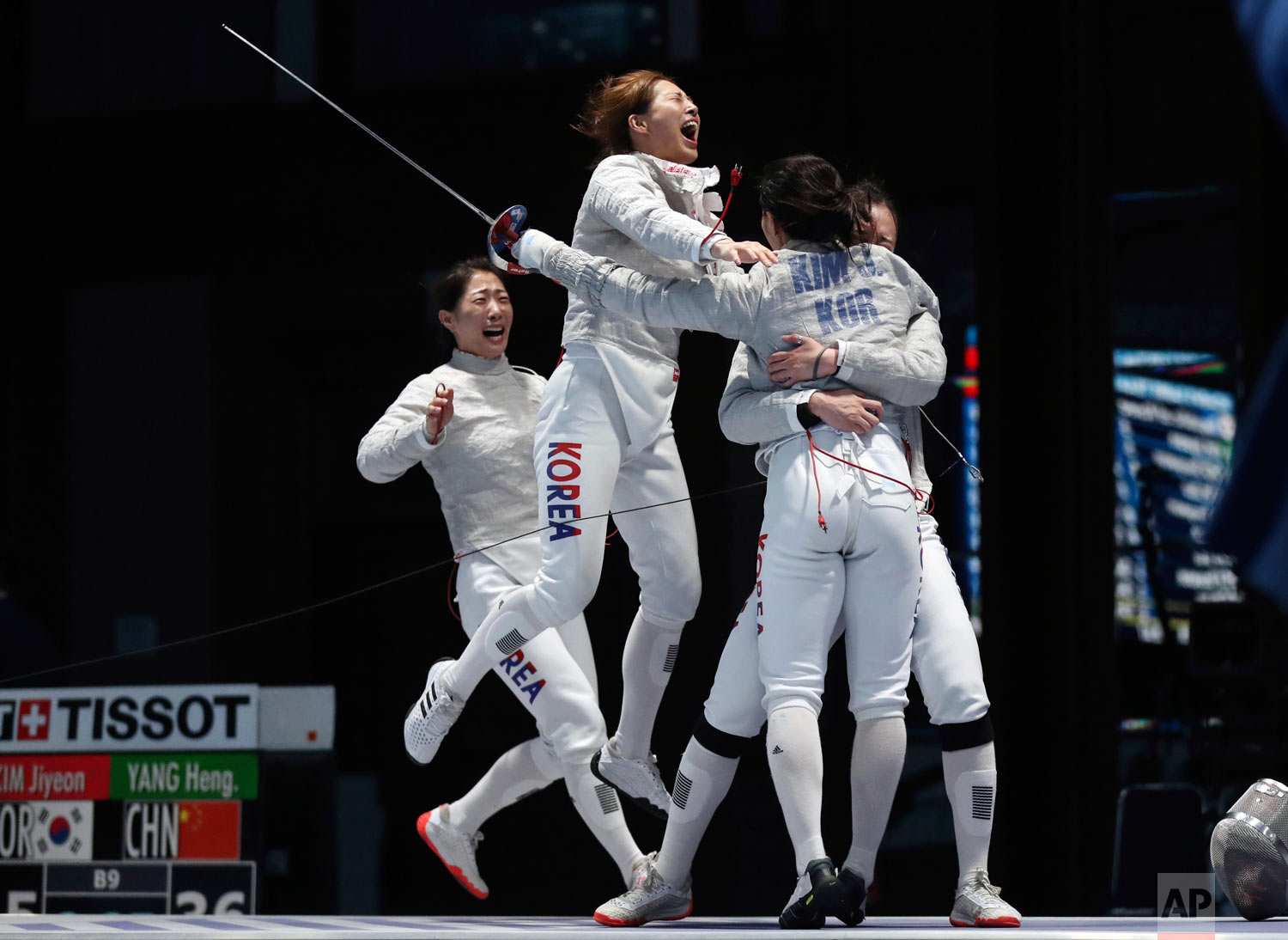 South Korea team members celebrate after defeating China during their women's sabre team finals fencing match at the 18th Asian Games in Jakarta, Indonesia, Wednesday, Aug. 22, 2018. (AP Photo/Achmad Ibrahim)