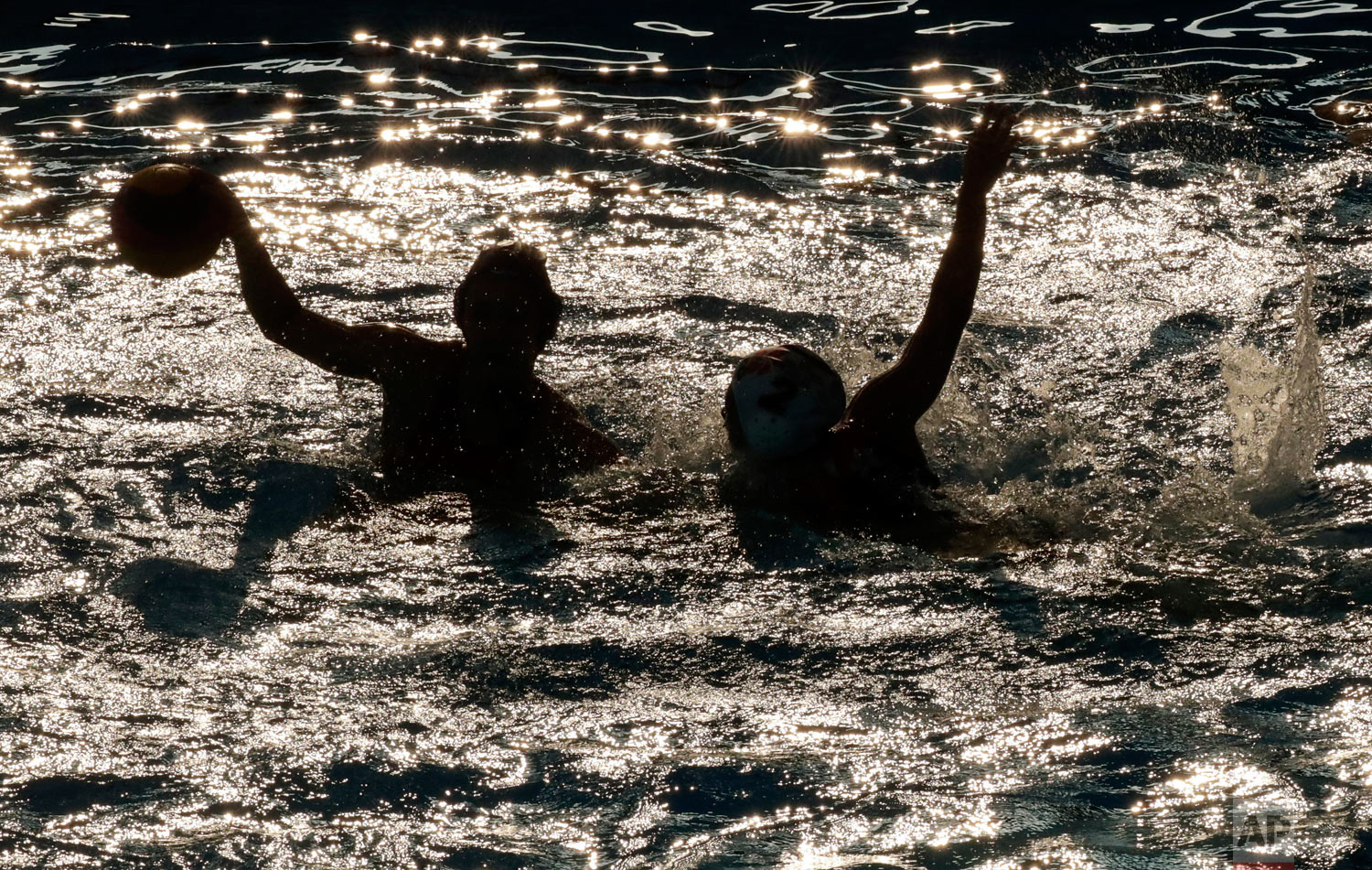 China and Hong Kong players in action during their women's water polo game at the 18th Asian Games in Jakarta, Indonesia, Tuesday, Aug. 21, 2018. (AP Photo/Lee Jin-man)