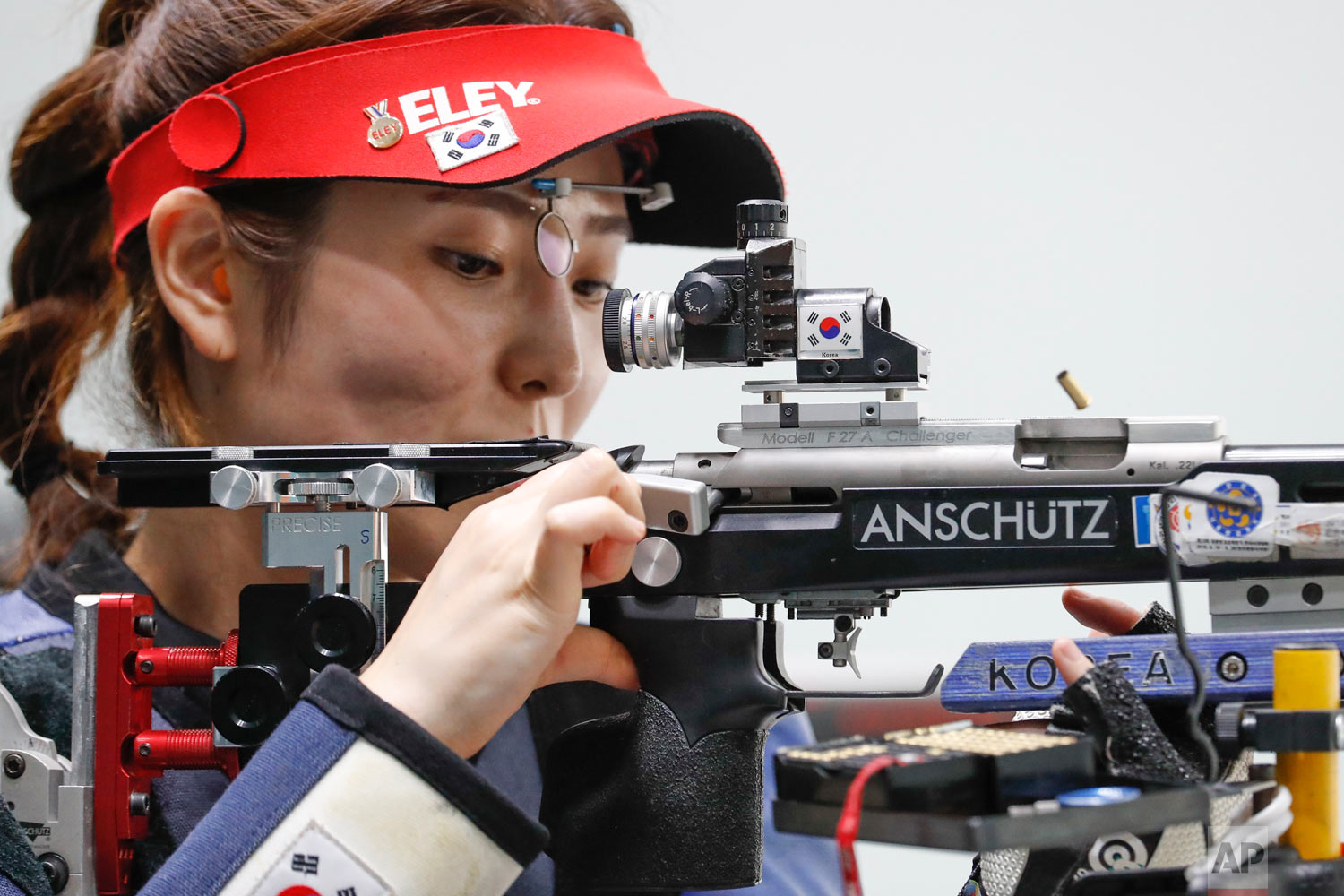 South Korea's Jeong Mira clears her rifle barrels during the shoots in the final round of the 50m rifle 3 positions women's shooting event during the 18th Asian Games in Palembang, Indonesia, Wednesday, Aug. 22, 2018. (AP Photo/Vincent Thian)