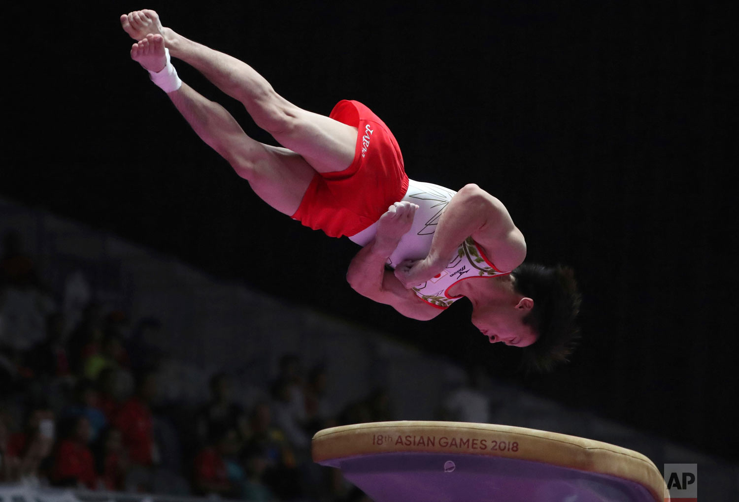 Japan's Fuya Maeno competes on the vault during the men's individual all-around gymnastics competition at the 18th Asian Games in Jakarta, Indonesia, Monday, Aug. 20, 2018. (AP Photo/Dita Alangkara)