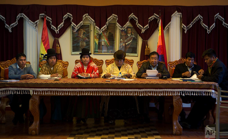 In this July 25, 2018 photo, Batallas Councilwoman Lidia Maria Quispe, from second left, Council Vice President Sonia Alanoca Tito and Council President Rosa Condori Cadena, attend a council meeting in Batallas, Bolivia. (AP Photo/Juan Karita)