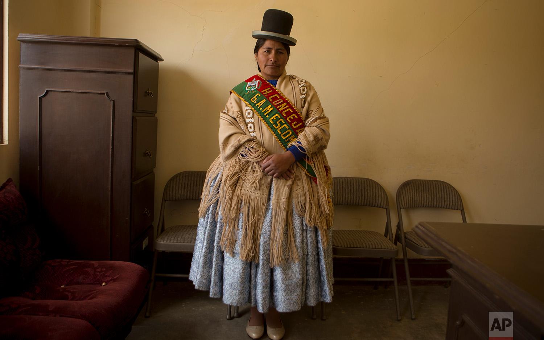 In this June 30, 2018 photo, Escoma Councilwoman Marcela Huanca, pose for a photo wearing her official sash, in Escoma, Bolivia. (AP Photo/Juan Karita)