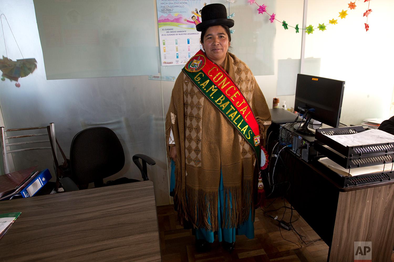 In this July 25, 2018 photo, Batallas Councilwoman Lidia Maria Quispe, poses for photo wearing her official sash, in Batallas, Bolivia. (AP Photo/Juan Karita)