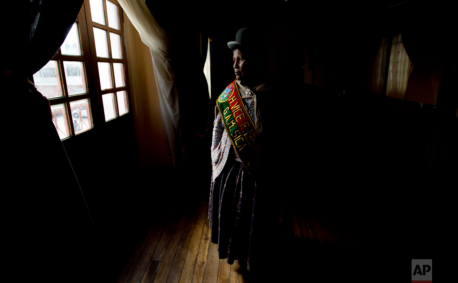 In this July 18, 2018 photo, Sica Sica Councilwoman Damiana Condori, who said she gave up her position due to harassment from the male alternate, poses for a photo in Sica Sica, Bolivia. (AP Photo/Juan Karita)