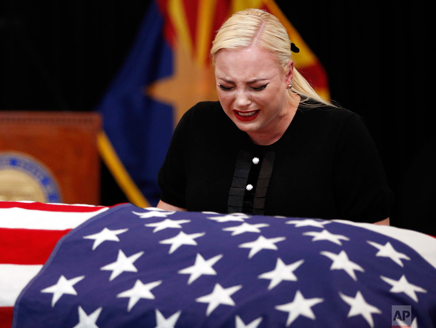 Meghan McCain, daughter of Sen. John McCain, R-Ariz., cries at the casket of her father during a memorial service at the Arizona Capitol on Wednesday, Aug. 29, 2018, in Phoenix. (AP Photo/Jae C. Hong, Pool)