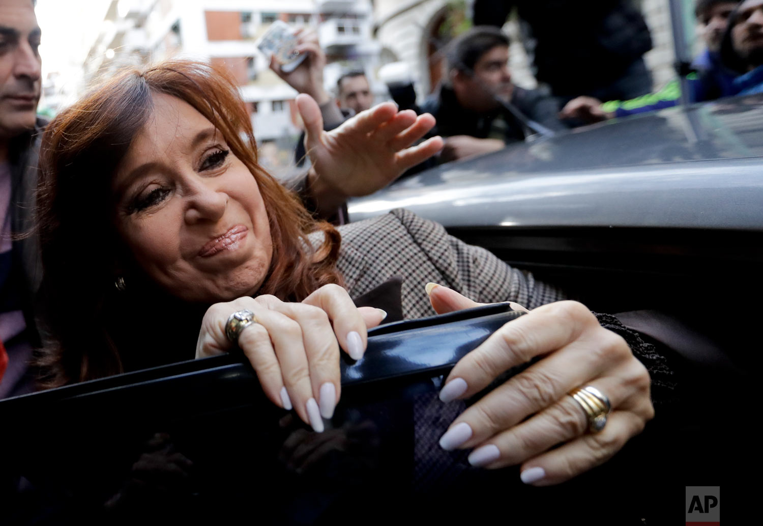Argentina's former President Cristina Fernandez gets into a car to go to a court hearing in Buenos Aires, Argentina, Aug. 13, 2018. Fernandez is expected to give testimony as part of a corruption probe sparked by the recent release of an investigation on illicit dealings during the governments of the ex-president, her late husband and predecessor, Nestor Kirchner.  (AP Photo/Natacha Pisarenko)