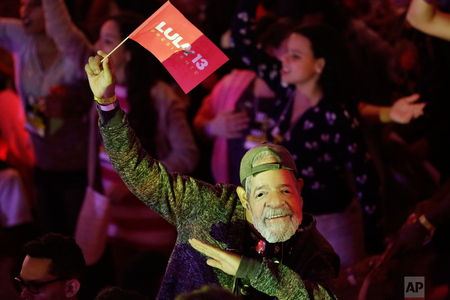 A man wears a mask depicting the Brazil's former President Luiz Inacio Lula da Silva during a Workers Party national convention in Sao Paulo, Brazil, Aug. 4, 2018. The convention confirmed the jailed Lula da Silva as their candidate for the country's presidency in October's election. Da Silva leads the polls by a large margins, but is likely to be barred by Brazil's electoral justice. (AP Photo/Nelson Antoine)