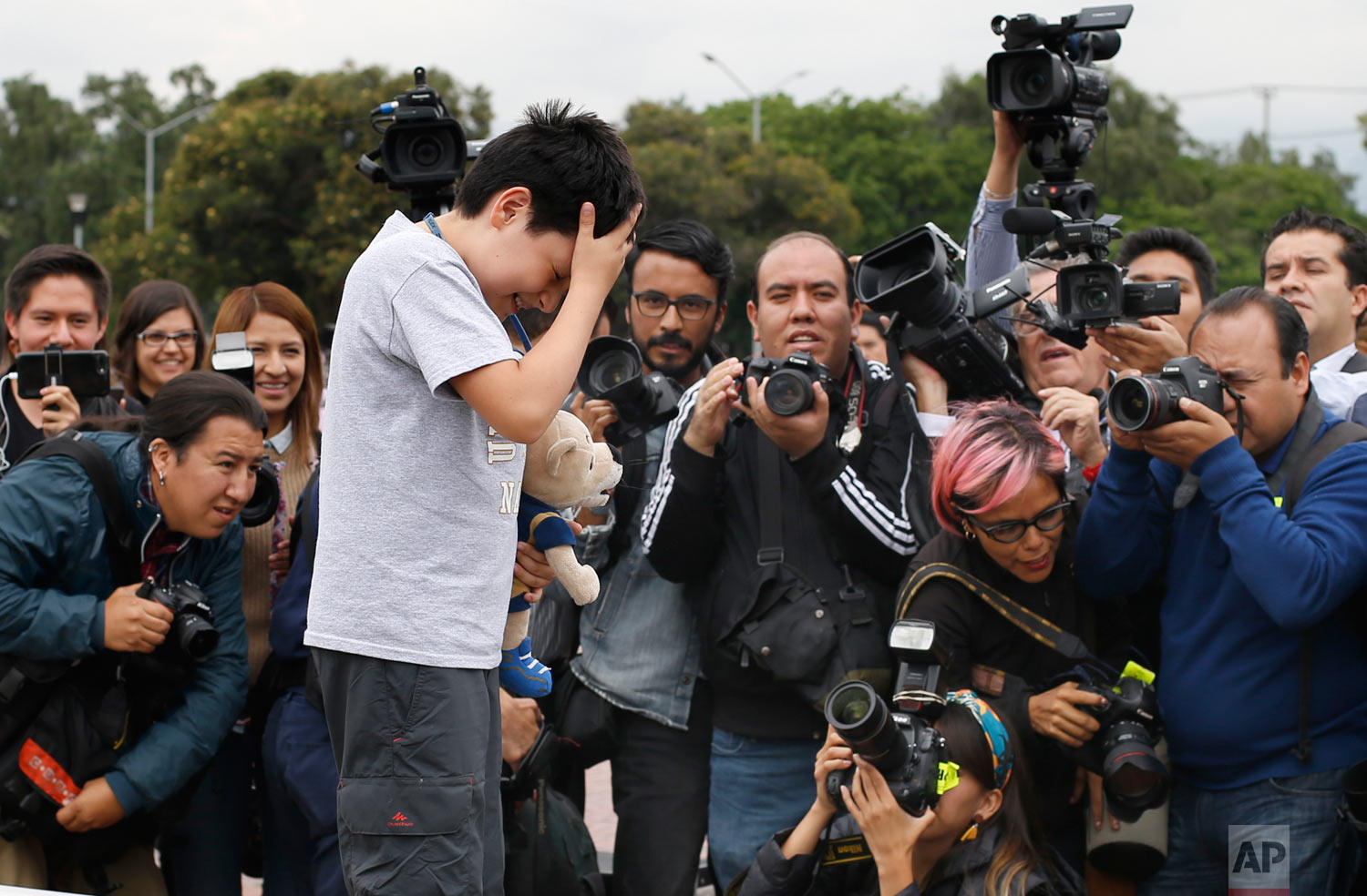 12-year-old Carlos Santamaria Diaz poses for photographers during a press event at Mexico's National Autonomous University in Mexico City, Friday, Aug. 3, 2018. The university, better known by its Spanish initials as the UNAM, said Thursday that Carlos Santamaria Diaz is the youngest such student in the university's roughly century-long history.(AP Photo / Marco Ugarte)