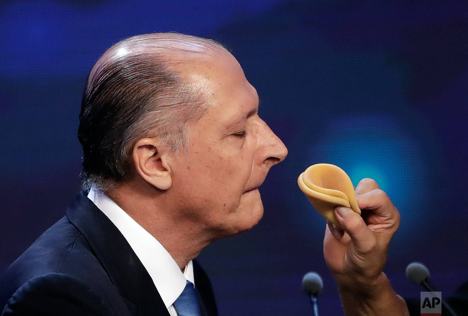 Geraldo Alckmin, former Sao Paulo governor and presidential hopeful with the Social Democratic Party, gets his make up done during a break at a presidential debate in Sao Paulo, Brazil, Aug. 10, 2018. Brazil will hold general elections on Oct. 7. (AP Photo/Andre Penner)