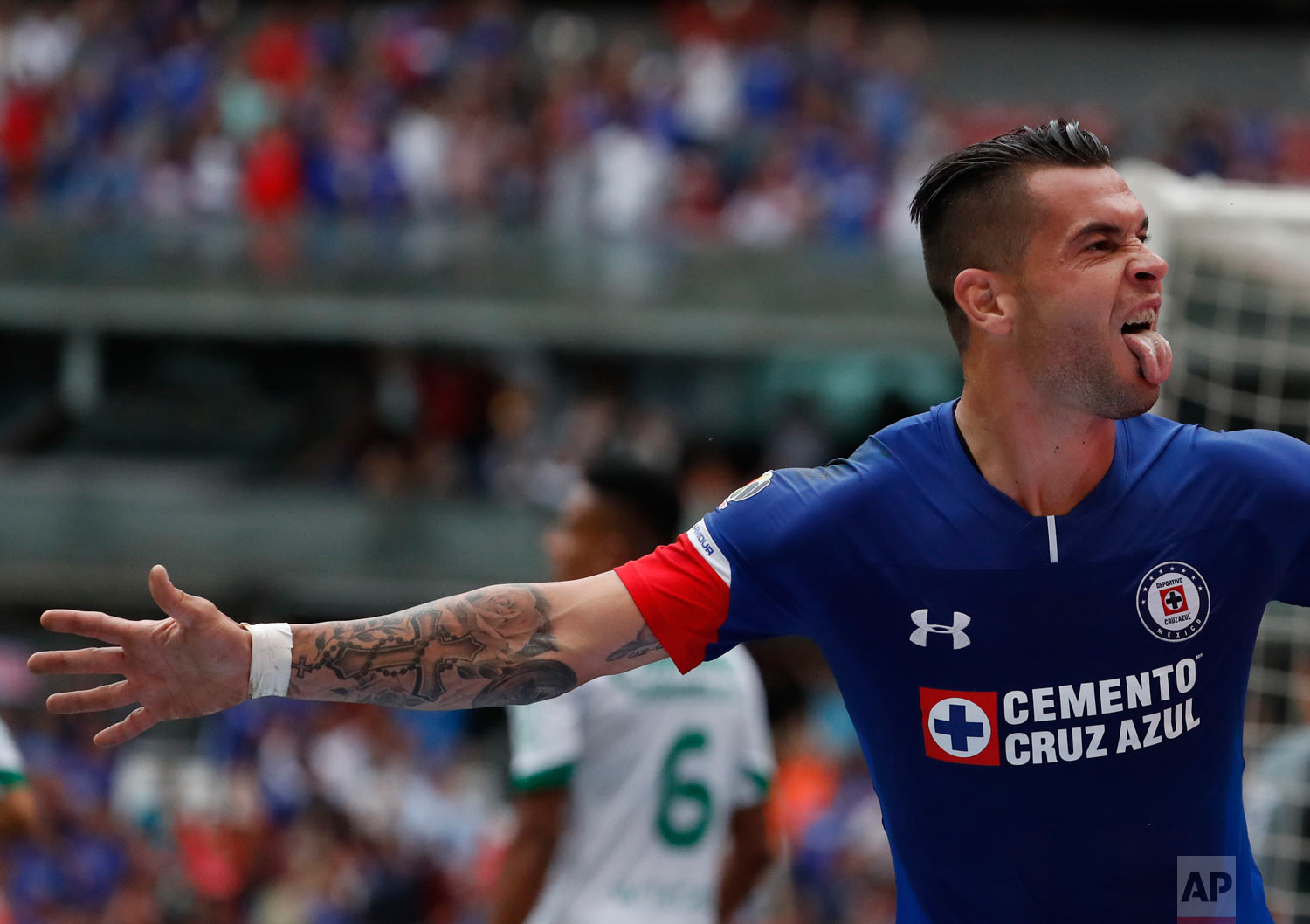 Cruz Azul's Caraglio Milton celebrates after scoring against Leon during a national league soccer match at Azteca Stadium in Mexico City, Aug. 18, 2018. (AP Photo/ Eduardo Verdugo)