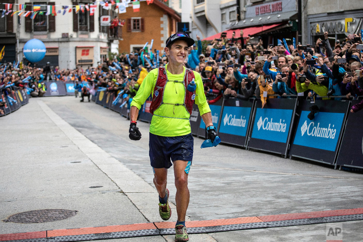 Xavier Thevenard, of France, reacts as he crosses the finish line to win the 170km Ultra-Trail of Mont-Blanc (UTMB), in the center of Chamonix, French Alps, Sept 1, 2018. (AP Photo/Laurent Cipriani)