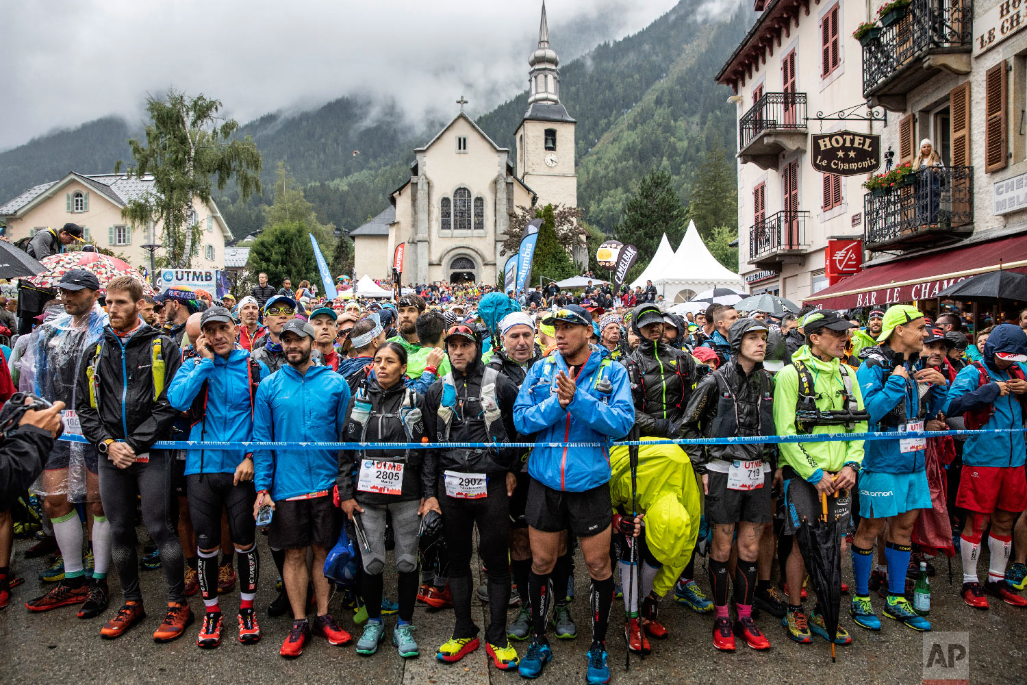 Competitors wait in the rain for the start of the 170km Ultra-Trail of Mont-Blanc (UTMB) race around the Mont-Blanc, crossing France, Italy and Switzerland, in Chamonix, French Alps, Aug. 31, 2018. (AP Photo/Laurent Cipriani)