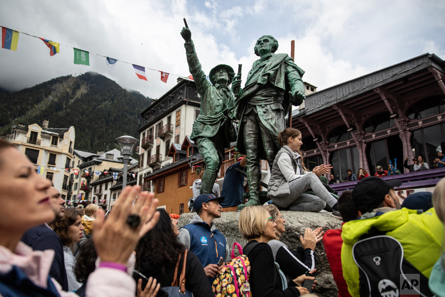 Supporters wait for the arrival of Xavier Thevenard, the winner of the 170km Ultra-Trail Mont-Blanc (UTMB), in the center of Chamonix, French Alps, Sept 1, 2018. (AP Photo/Laurent Cipriani)