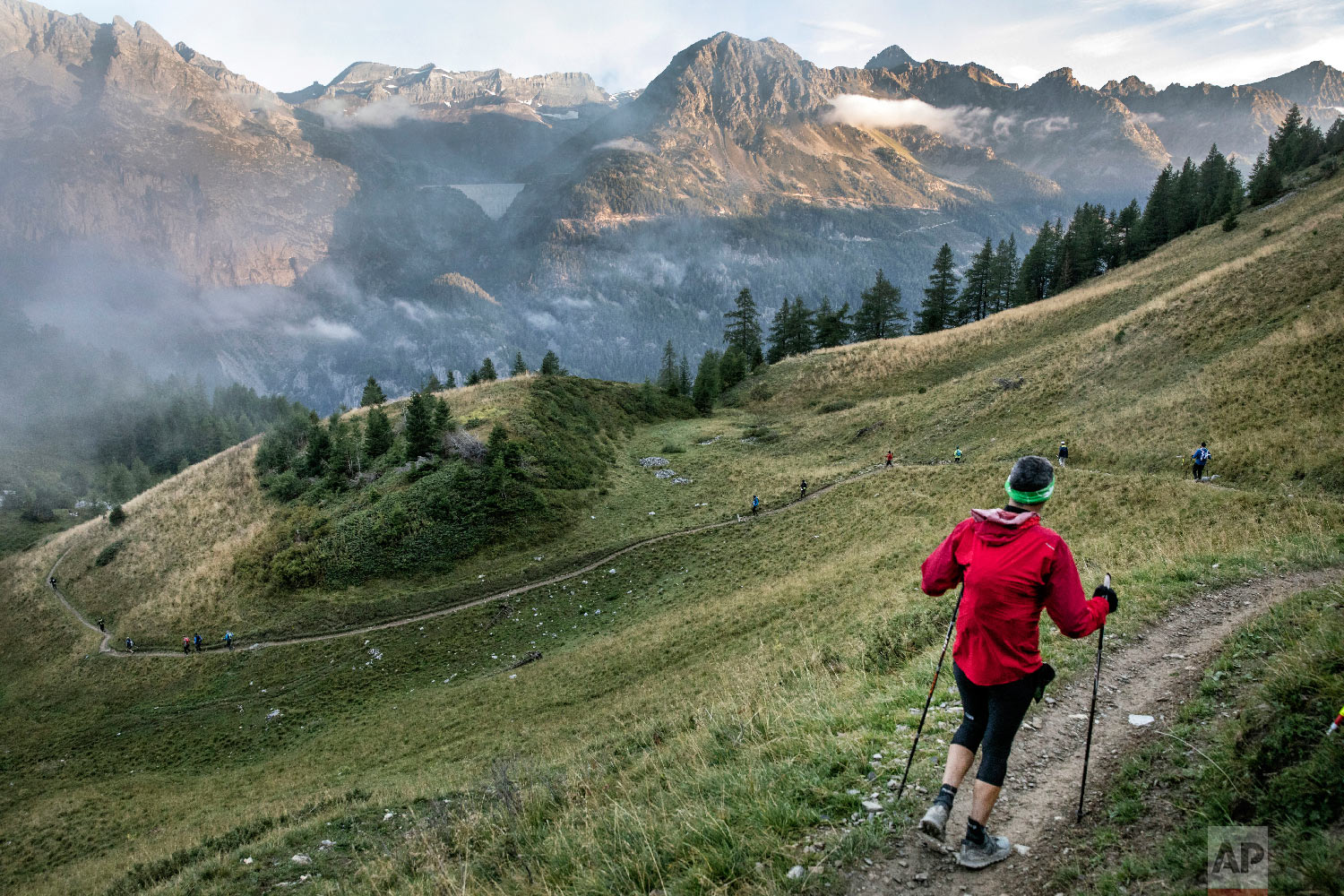 Competitors run as they compete in the 170km Ultra-Trail of Mont-Blanc (UTMB) race, near Chamonix, French Alps, Sept 2, 2018. (AP Photo/Laurent Cipriani)