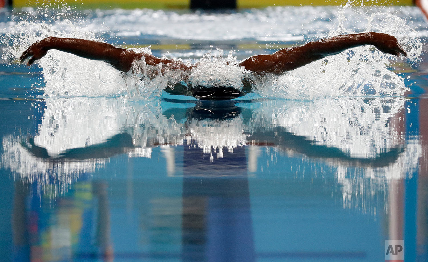 In this Wednesday, Aug. 22, 2018 photo, India's Sajan Prakash swims in his heat of the men's 100m butterfly during the swimming competition at the 18th Asian Games in Jakarta, Indonesia. (AP Photo/Lee Jin-man)
