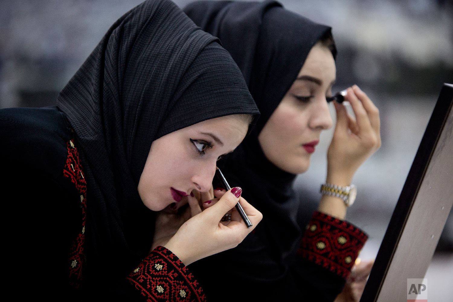 Palestinian brides prepare prior to a mass wedding event in the West Bank city of Ramallah, Saturday, Aug. 18, 2018. 252 Palestinian couples participated in the ceremony. (AP Photo/Majdi Mohammed)