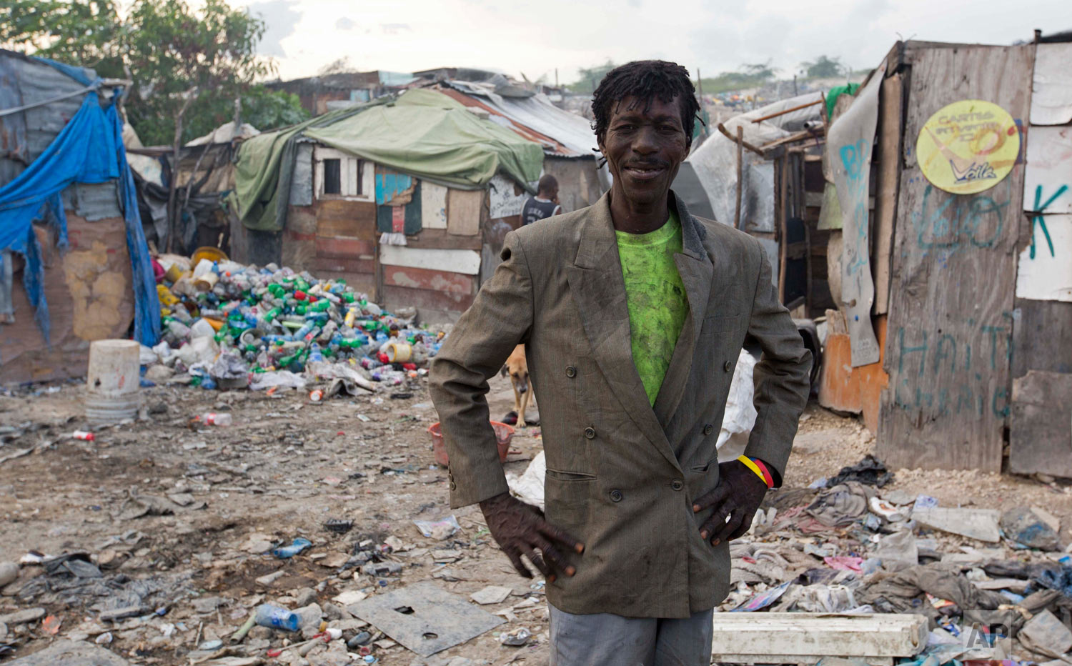Wilfrid Jocelyn, 52, poses for a portrait near his home on the edge of the landfill. (AP Photo/Dieu Nalio Chery)