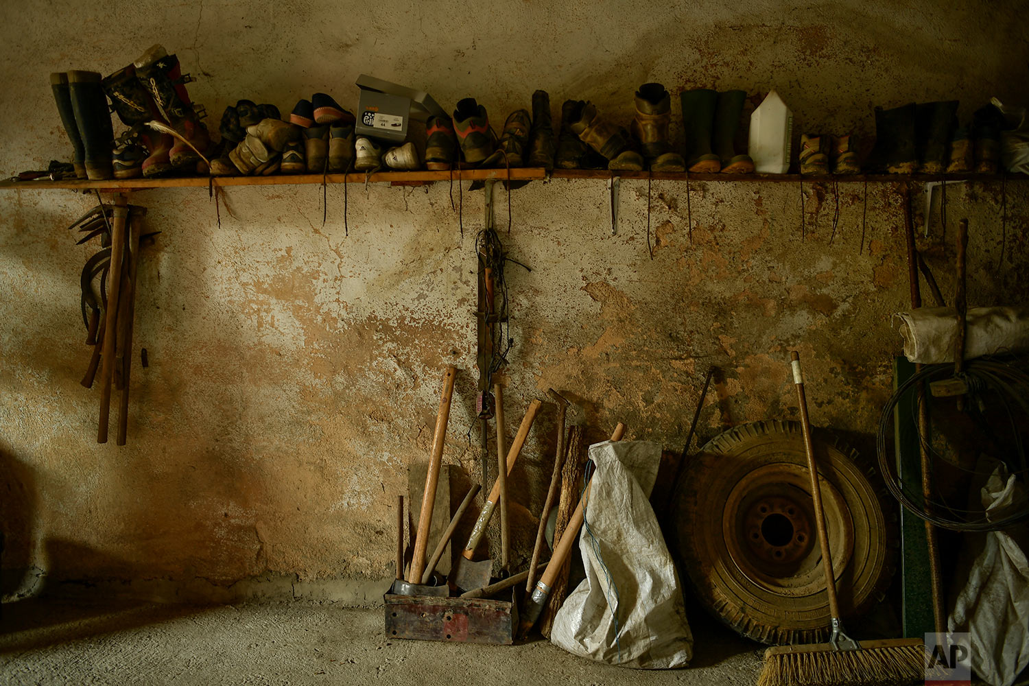In this Aug. 29, 2018 photo, work utensils are seen organized inside a room, to be used by workers to produce traditional charcoal in Viloria, northern Spain. (AP Photo/Alvaro Barrientos)