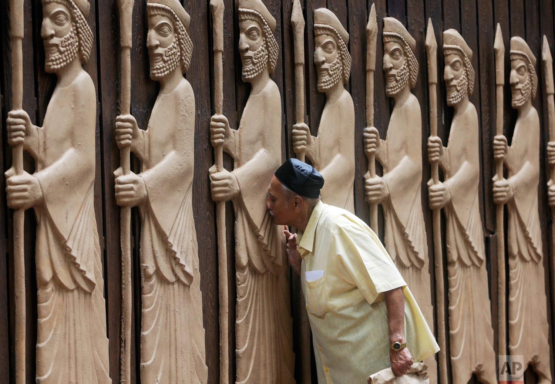 A Parsi offers prayers on their New Year in Mumbai, India, Friday, Aug. 17, 2018. (AP Photo/Rajanish Kakade)