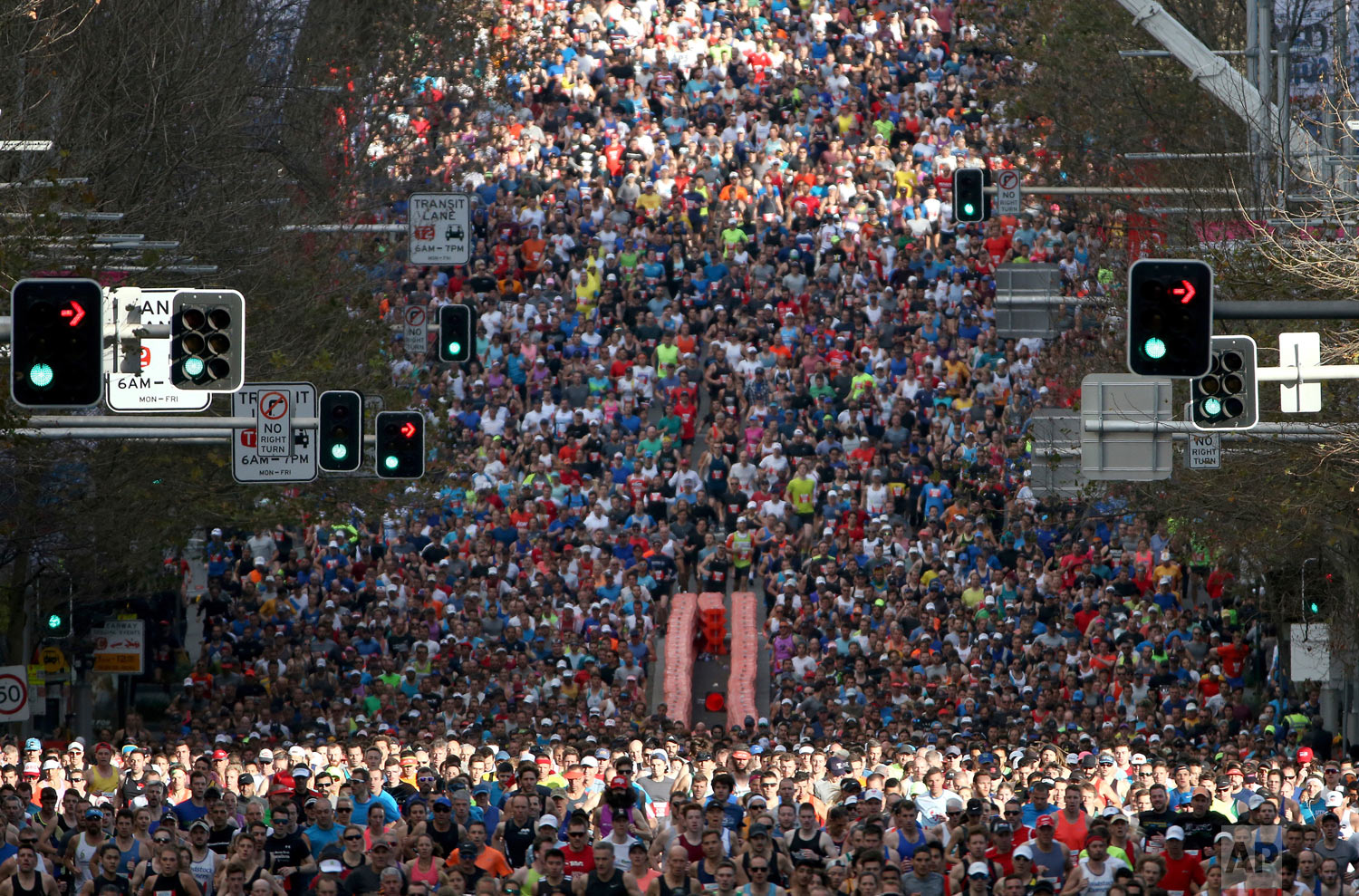 Some 80,000 participants in the annual City2surf fun run make their way along the 14 kilometers (8.7 miles) course in Sydney Sunday, Aug. 12, 2018. (AP Photo/Rick Rycroft)