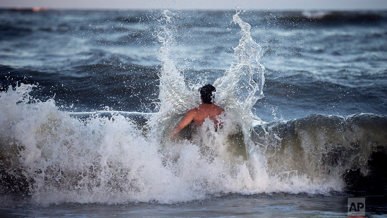 Body surfer Andrew Vanotteren, of Savannah, Ga., crashes into waves from Hurricane Florence, Wednesday, Sept., 12, 2018, on the south beach of Tybee Island, Ga. (AP Photo/Stephen B. Morton)