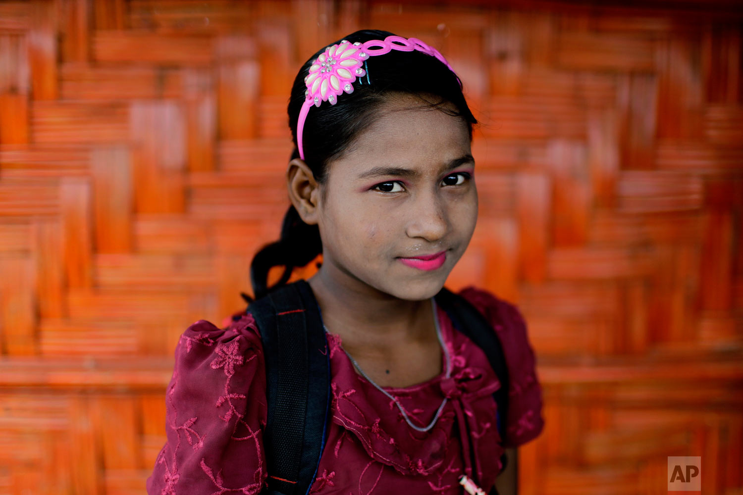 Shamshoda, 10, poses for a portrait in front of her classroom on June 27, 2018, in Chakmarkul refugee camp, Bangladesh. (AP Photo/Wong Maye-E)