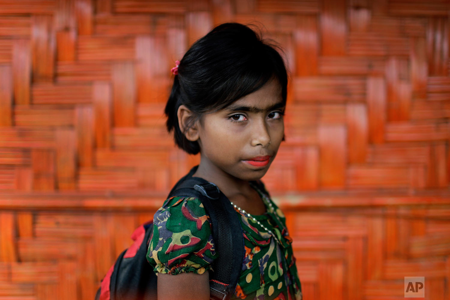 Taslima, 10, poses for a portrait in front of her classroom on June 27, 2018, in Chakmarkul refugee camp, Bangladesh. (AP Photo/Wong Maye-E)